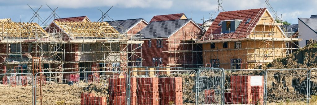 A partially built housing development: Liberal Democrats' plan to tackle the housing crisis.