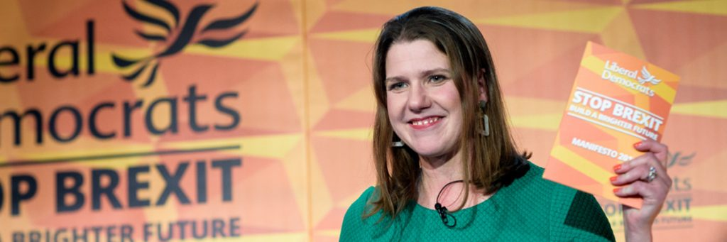 Jo Swinson holding the Liberal Democrat manifesto.